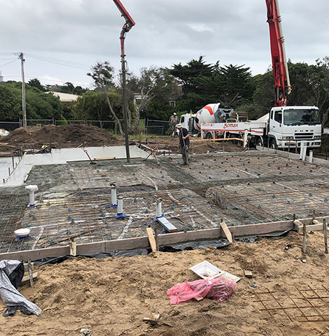 worker and waffle pod concrete slab