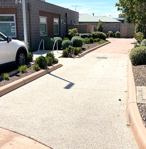 completed exposed aggregate concrete driveway