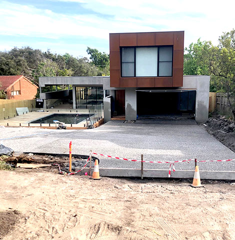 exposed aggregate concrete driveway in progress